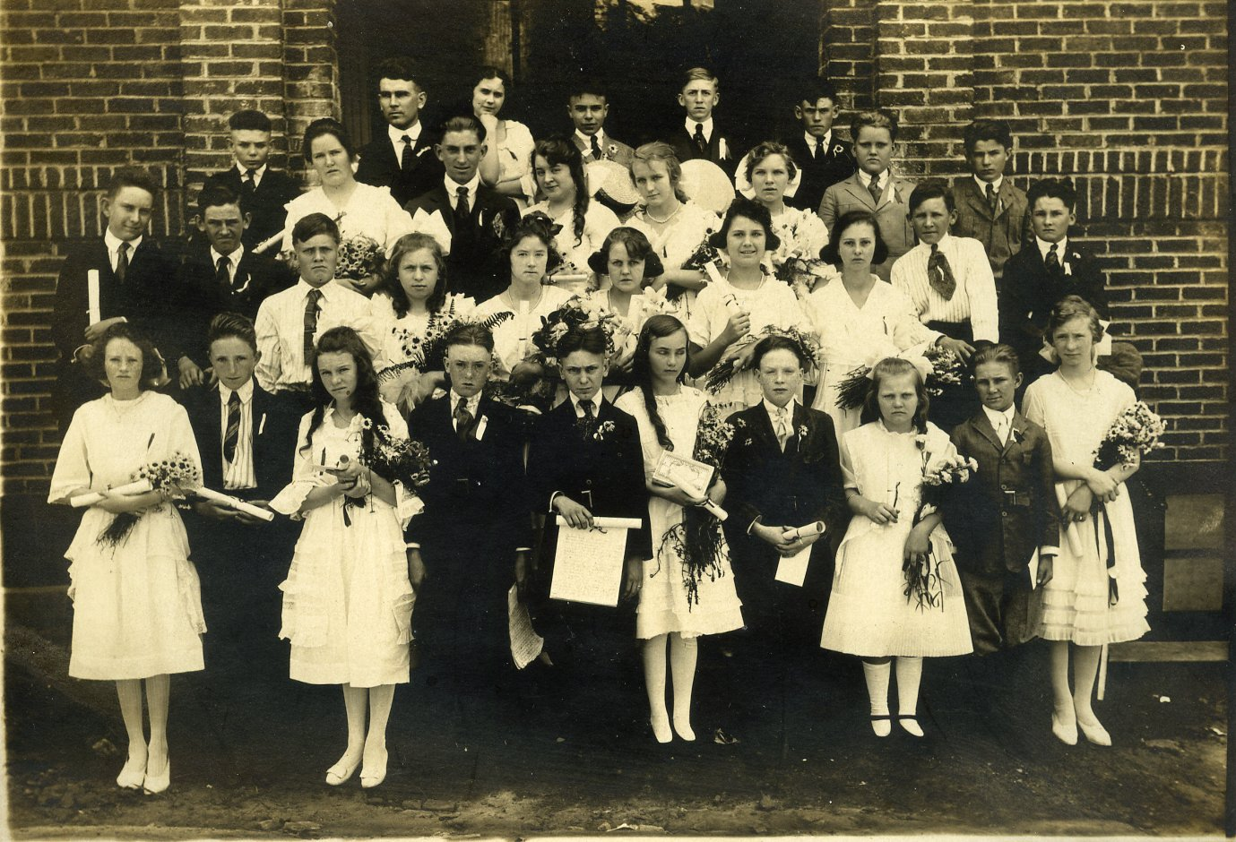Hapeville College Street School c 1924 7th Grade.<br> Row 1: Unknown; Unknown; Gladys Jones; Frank Peebles; Asbury Bryant; Merle Perdue; Wayne Smith; Marie Meertier; Lawrence Campbell; Esther Lassiter<br> Row c2: Claud Hines; Elmer Dailey; Unknown; Eleanor Pace; Ethel Harrison; Unknown; Helen Holland; Unknown; William Akin<br> Row 3: Unknown; Unknown; Dan Wells; Esther Volan; Katheryn Dunn; Aeive Golbert; Neill Leach; Unknown<br> Row 4: Jere Wells, teacher; Unknown; E G Webb; Unknown Unknown
