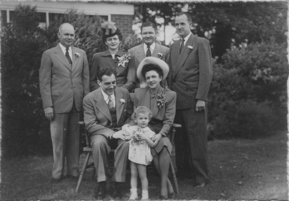 Iris Keen Lewis married Jack Robertson 24 September 1947. Kirby Lewis was the flower girl.  The wedding was performed at the Humphries home on E. Rock Springs Road in Atlanta, Georgia. Seated: Mr. & Mrs. Jack Barker Robertson.  Standing: John D. & Demaris K. Humphries; Frank Guest; and officiating minister.
