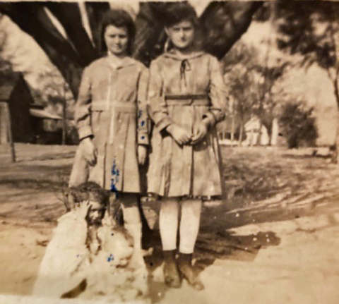 Ruth and Willie Nelle standiing, Iris<br> and Demaris Keen on the ground