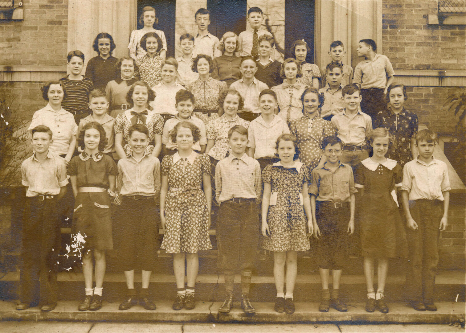 Bernice Jones School Class estimated 1935-1938.  Bernice (daughter of Chester Jones) is the girl in the center of the third row.