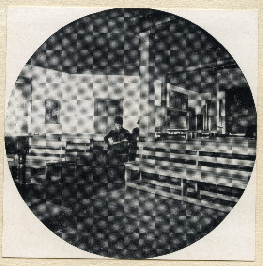 Classroom for Law 1893 in the Ivy Building.  Joseph W Humphries seated; Edward T Moon in background